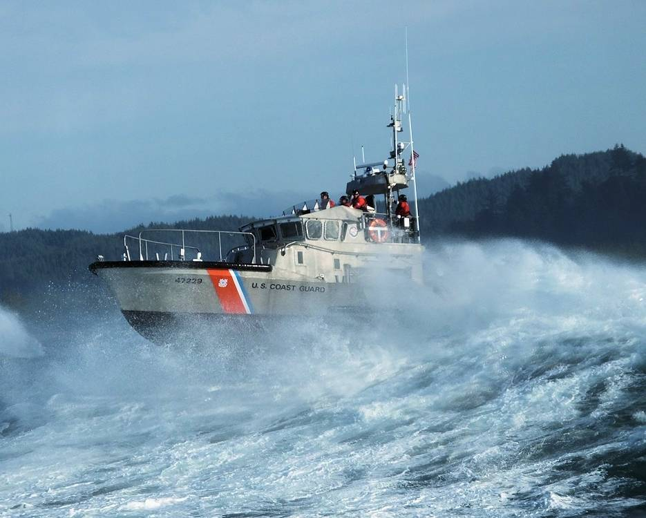 Petty Officer 2nd Class Enrique Lemos (surfman #559) operates a 47-foot Motor Lifeboat near the entrance to the Umpqua River in Winchester Bay, Oregon, December 26, 2019. Lemos was one of 10 Coast Guardsmen to certify as a surfman during the winter and spring. (U.S. Coast Guard photo courtesy of Petty Officer 2nd Class Enrique Lemos)
