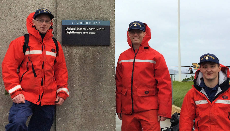 February 27, 2019 - Petty Officer 1st Class John Sherwood, Petty Officer 2nd Class Geoffrey Cote, and Fireman Harley Satara from Aids to Navigation Team San Francisco stand beside Alcatraz Lighthouse that has stood in the center of San Francisco Bay since 1909. (U.S. Coast Guard photo by Chief Petty Officer Marcelino Ortiz)