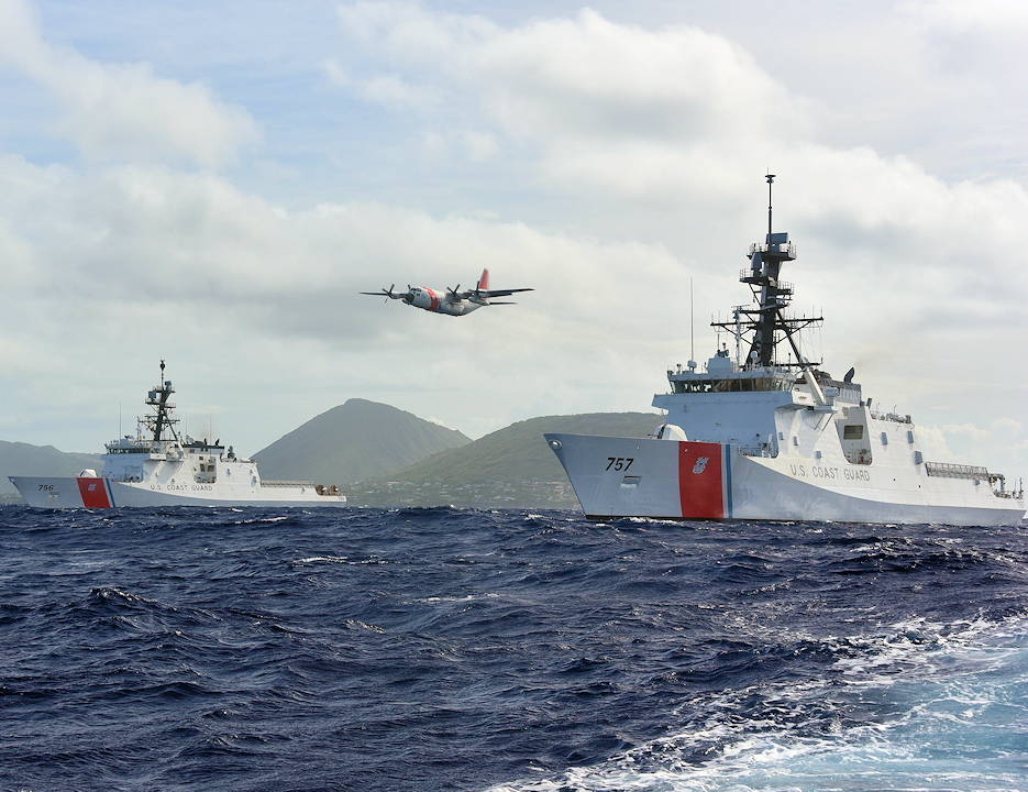 August 16, 2019 - Coast Guard Cutter Midgett (WMSL 757), right, meets Coast Guard Cutter Kimball (WMSL 756) off Diamond Head, while a C-130 Hercules aircraft from Air Station Barbers Point flies between them. (U.S. Coast Guard photo by Chief Petty Officer John Masson)