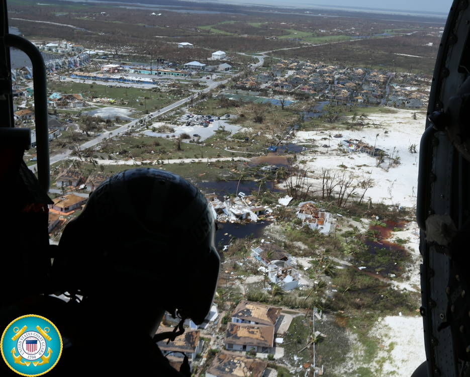 September 4, 2019 - Petty Officer 2nd Class Mike Lewis observes the damage by Hurricane Dorian in support of search and rescue and humanitarian aid in the Bahamas. The Coast Guard is supporting the Bahamian National Emergency Management Agency and the Royal Bahamian Defense Force, who are leading search and rescue efforts in the Bahamas. (Image created by USA Patriotism! from U.S. Coast Guard photo by Seaman Erik Villa Rodriguez)