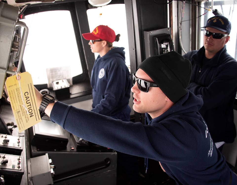 December 28, 2019 - Coast Guard Ensign Walter Daniels operates a radio while Lt. Cmdr. Karen Kutkiewicz (left) steers the Coast Guard Cutter Polar Star through pack ice about 200 miles north of McMurdo Station, Antarctica. The 43-year-old Polar Star is the nation's only heavy icebreaker, and the crew is heading to McMurdo Station to escort refuel and resupply ships through the ice, which can be as thick as 10 feet. This year marks the 64th iteration of the operation known as Operation Deep Freeze. (U.S. Coast Guard photograph by Senior Chief Petty Officer NyxoLyno Cangemi)