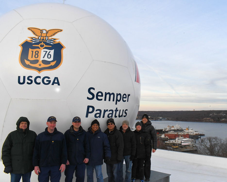 Members of the antenna construction team outside the radome atop of Smith Hall at the Coast Guard Academy in New London, Conn., Jan. 1, 2019. The antenna construction team: David Ping, Aerospace); Lt. Cmdr. Grant Wyman, Coast Guard Research and Development Center; Petty Officer 1st Class Christopher Moore, Coast Guard Academy; Mark Galves, and Tatsuya Kawase, Aerospace; David Rigmaiden, Noah Weitz, and Giovanni Minelli, U.S. Naval Postgraduate School. (U.S. Coast Guard photo courtesy of the Coast Guard Research and Development Center)