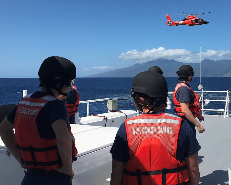 October 24, 2019 - The crew of the Coast Guard Fast Response Cutter William Hart (WPC 1134) standby after a Coast Guard Air Station Barbers Point MH-65 Dolphin helicopter crew hoisted it's rescue basket with Oscar, a simulated rescue dummy, during a search and rescue exercise near Kapalua, Maui. (Image created by USA Patriotism! from U.S. Coast Guard photo by Petty Officer 2nd Class Jim Connor)