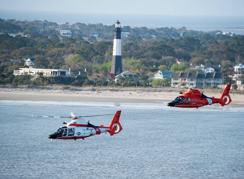 March 15, 2019 - Two Coast Guard Air Station Savannah MH-65 Dolphin helicopters fly in formation in front of the Tybee Island Lighthouse, as the Cutter Eagle transits down the Savannah River towards Savannah, Georgia. Air Station Savannah welcomed the Eagle crew as they arrived in Savannah for St. Patrick's Day weekend. (U.S. Coast Guard photo by Petty Officer 3rd Class Ryan Dickinson)