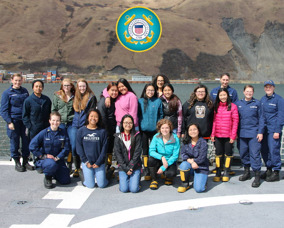 May 6, 2019 - Coast Guard Cutter Douglas Munro (WHEC 724) female crew members with a group of Kodiak High School female students during a women in engineering day aboard the cutter in Kodiak, Alaska. Students were given a tour of the engine room, a welding demonstration, hands-on electrical troubleshooting training, and the opportunity to try their hands at saving the ship in the event of an emergency by learning damage control skills. (Image created by USA Patriotism! from U.S. Coast Guard photo by Ensign Jacob Marx)