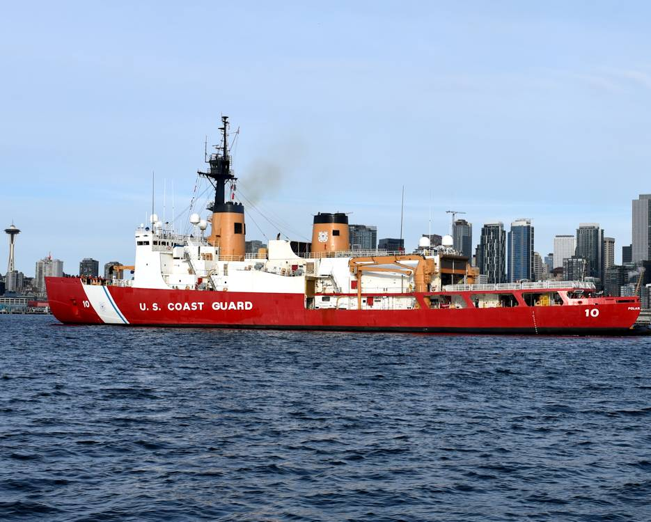 November 26, 2019 - U.S. Coast Guard Cutter Polar Star (WAGB 10) transits Elliott Bay with the skyline of Seattle, Washington in the background. The cutter is scheduled to assist with ice breaking operations in McMurdo Sound near Antarctica during Operation Deep Freeze 2020. (U.S. Coast Guard photo by Petty Officer 2nd Class Steve Strohmaier)