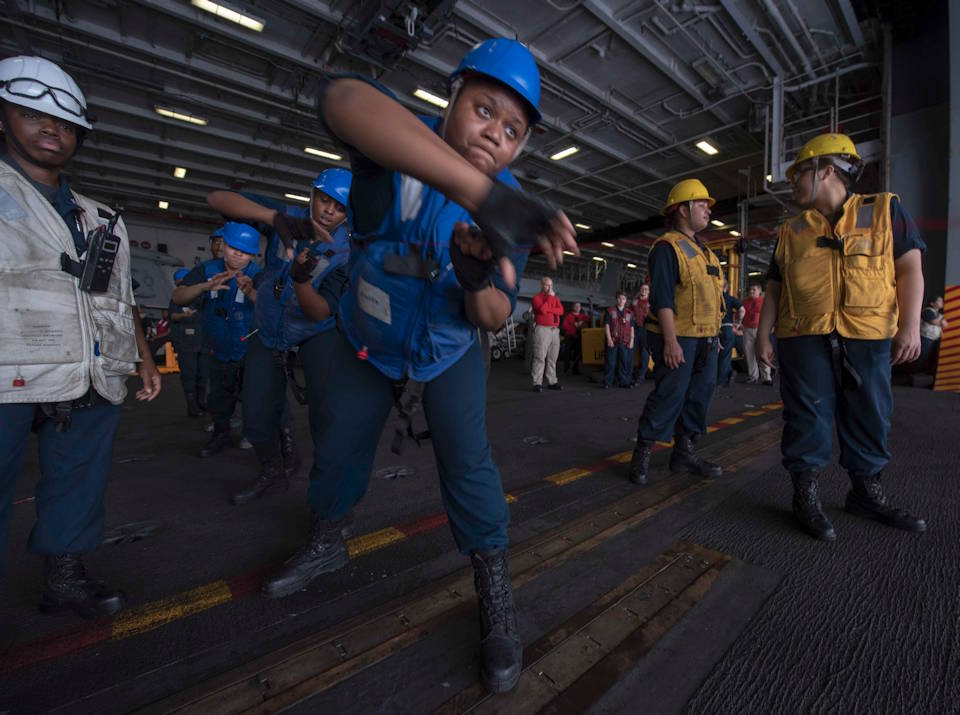 August 1, 2019 - Sailors assigned to the Navy's forward-deployed aircraft carrier USS Ronald Reagan (CVN 76) handle line during a replenishment-at-sea with the Military Sealift Command's fleet replenishment oiler USNS Walter S. Diehl (T-AO 193). Twenty-one Sailors assigned to Deck Department formed the first all-female underway replenishment rig team in the ship's history. Ronald Reagan, the flagship of Carrier Strike Group 5, provides a combat-ready force that protects and defends the collective maritime interests of its allies and partners in the Indo-Pacific region. (U.S. Navy photo by Mass Communication Specialist 2nd Class Tyra M. Campbell)