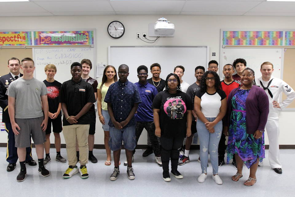 July 29, 2019 - Service members and Army Civilians representing U.S. Cyber Command (USCC) and the National Security Agency are teaching high school students from throughout Anne Arundel County Public Schools about the basics of cybersecurity as part of the Air Force Association (AFA) CyberPatriot CyberCamp at Meade High School. (U.S. Army photo by Steven Stover, 780th Military Intelligence Brigade)