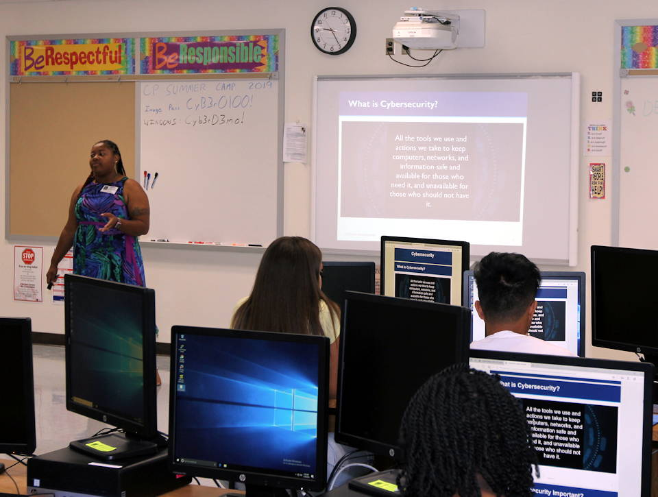 July 29, 2019 - April Taylor-Melton, a CyberPatriot mentor and battalion IT specialist with the 781st Military Intelligence (MI) Battalion (Cyber), 780th MI Brigade (Cyber), is teaching high school students about cyber security at the Air Force Association (AFA) CyberPatriot CyberCamp at Meade High School. (U.S. Army photo by Steven Stover, 780th Military Intelligence Brigade)