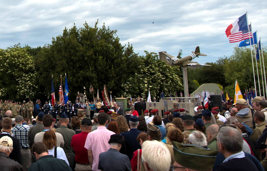 Hundreds of guests and active duty service members from the United States and Germany gather around the U.S. Air Force monument near the Eglise Saint-Candide de Picauville church for a ceremony honoring all airborne troops and flight crew that served on D-Day in Picauville, France, June 4, 2019. The ceremony was one of 55 ceremonies held between June 1 - 9 in honor of the 75th anniversary of D-Day. (U.S. Air Force photo by Senior Airman Kristof J. Rixmann)