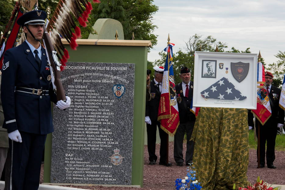 "A U.S. Air Force Base Honor Guard Airman stands at attention moments before a ceremony began to honor all airborne troops and flight crew that served on D-Day in Picauville, France on June 4, 2019. Behind him is a memorial plaque and framed decorations to honor the 439th Troop Carrier Group who crashed in the early hours on June 6, 1944. Inscribed on the memorial plaque, in French, reads: ""Mort pour notre Liberte,"" translating to ""Died for our Freedom."" (U.S. Air Force photo by Senior Airman Kristof J. Rixmann)"