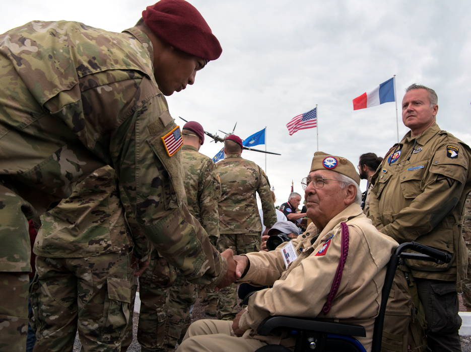 "A U.S. Army airborne infantryman shakes the hand of retired Private First Class Joseph Morettini, 82nd Airborne, 508th Regiment, Easy Company, during a ceremony held to honor all airborne troops and flight crew that served on D-Day in Picauville, France, June 4, 2019. On June 6, 1944, Morettini dropped from midnight skies into Normandy with the objective to overtake an enemy stronghold near Picauville. During the ceremony's conclusion, Morettini remarked to each active U.S. airborne infantrymen he shook hands with: ""I dropped here 75 years ago."" (U.S. Air Force photo by Senior Airman Kristof J. Rixmann)"