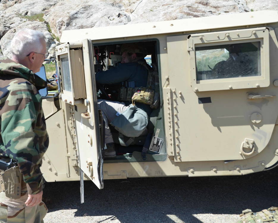 May 10, 2019 - A scientist observes a fellow scientist try squeezing into the seat of a tactical vehicle wearing the equipment a typical soldier would be wearing, in order to better understand how little room there is for bulky equipment. (Photo courtesy Dugway Proving Ground Public Affairs Office)