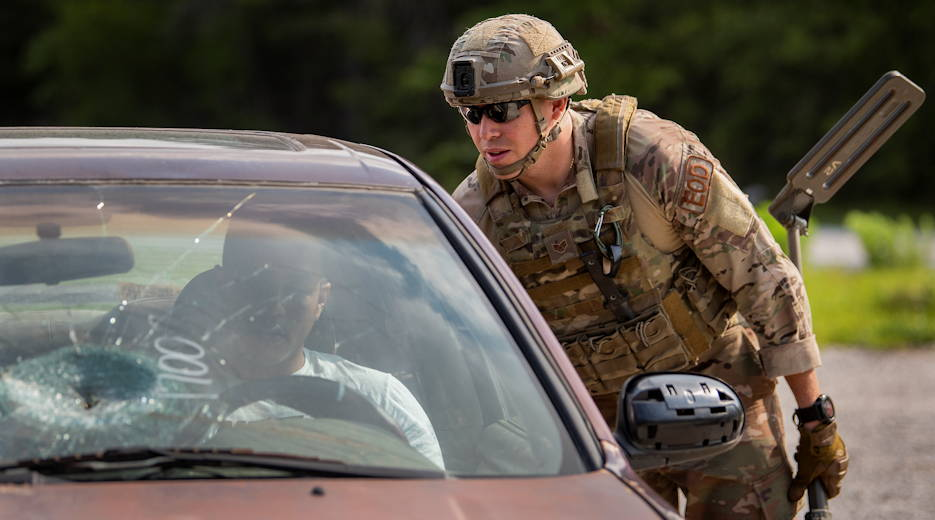 May 9, 2019 - U.S. Air Force Staff Sgt. AJ Massa, 6th Civil Engineer Squadron, examines a vehicle-borne improvised explosive device during the Warfighter Challenge at Eglin Air Force Base, FL. The Eglin-based exercise provides Airmen the chance to experience EOD problem-solving scenarios and network with others in the career field to help improve the mission. (U.S. Air Force photo by Samuel King)
