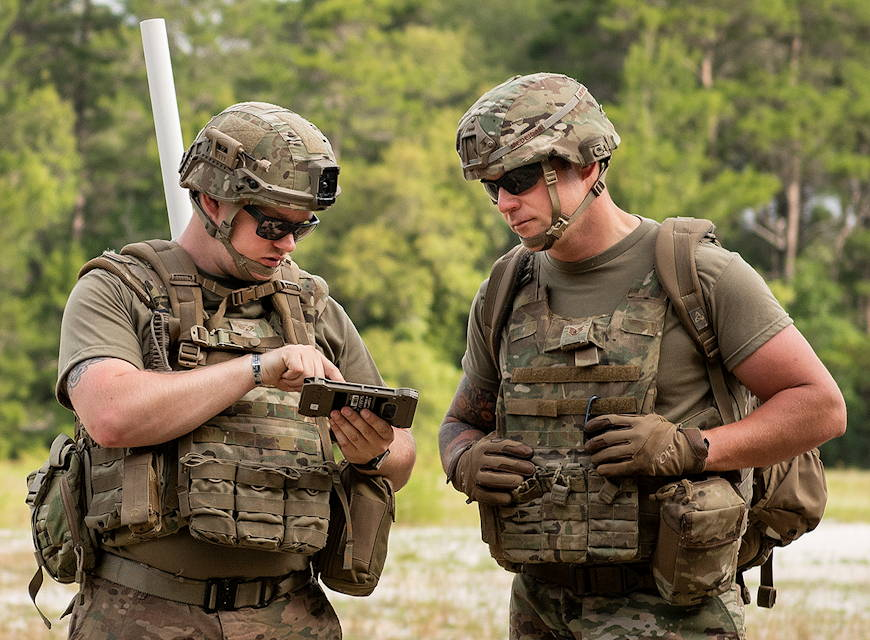 May 9, 2019 - Explosive ordnance disposal technicians use the Android Tactical Assault Kit communication device during a patrol at the Warfighter Challenge at Eglin Air Force Base, FL. (U.S. Air Force photo by Samuel King)