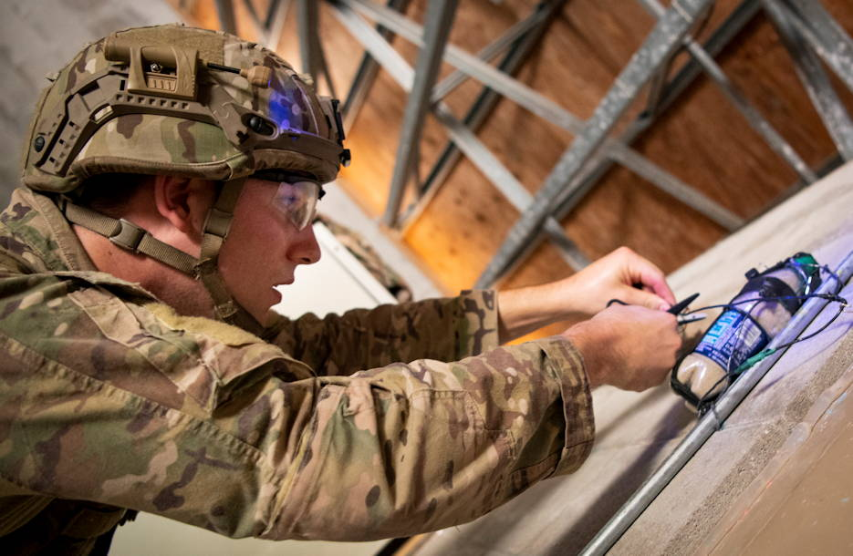 May 9, 2019 - Staff Sgt. Austin Kotch, 35th Civil Engineer Squadron, cuts a wire on an improvised explosive device at the Warfighter Challenge at Eglin Air Force Base, FL. (U.S. Air Force photo by Samuel King)