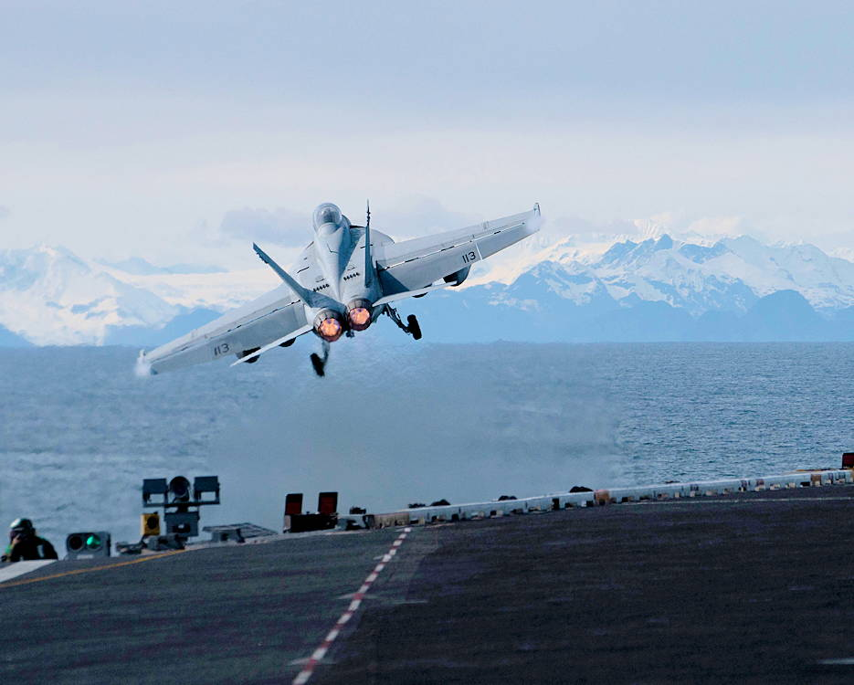 "May 13, 2019 - An F/A-18F Super Hornet, assigned to the ""Black Knights"" of Strike Fighter Squadron (VFA) 154, launches from the flight deck of the aircraft carrier USS Theodore Roosevelt (CVN 71) while participating in Exercise Northern Edge 2019. (U.S. Navy photo by Mass Communication Specialist 3rd Class Andrew Langholf)"