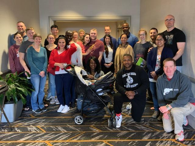 March 9, 2019 - 1st Theater Sustainment Command (TSC) Soldiers and families gather for a group picture at a Strong Bonds couple's retreat weekend held at the Sheraton Hotel in Nashville, TN. Strong Bonds is a chaplain-led program that aims to build relationship resiliency. (Courtesy photo)