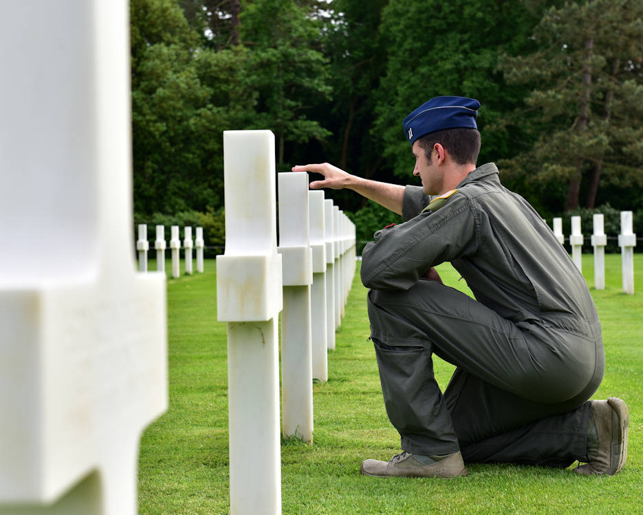 U.S. Air Force Captain Michael DeSandre, 41st Airlift Squadron pilot, visits the World War II gravesite of fallen U.S. Army Pvt. Joseph Costa Jr. at the Normandy American Cemetery and Memorial, Colleville-sur-Mer France on June 3, 2019. Pvt. Costa was very close to DeSandres' family and he took this opportunity to pay his respects. (U.S. Air Force photo by Staff Sgt. Jeremy McGuffin)