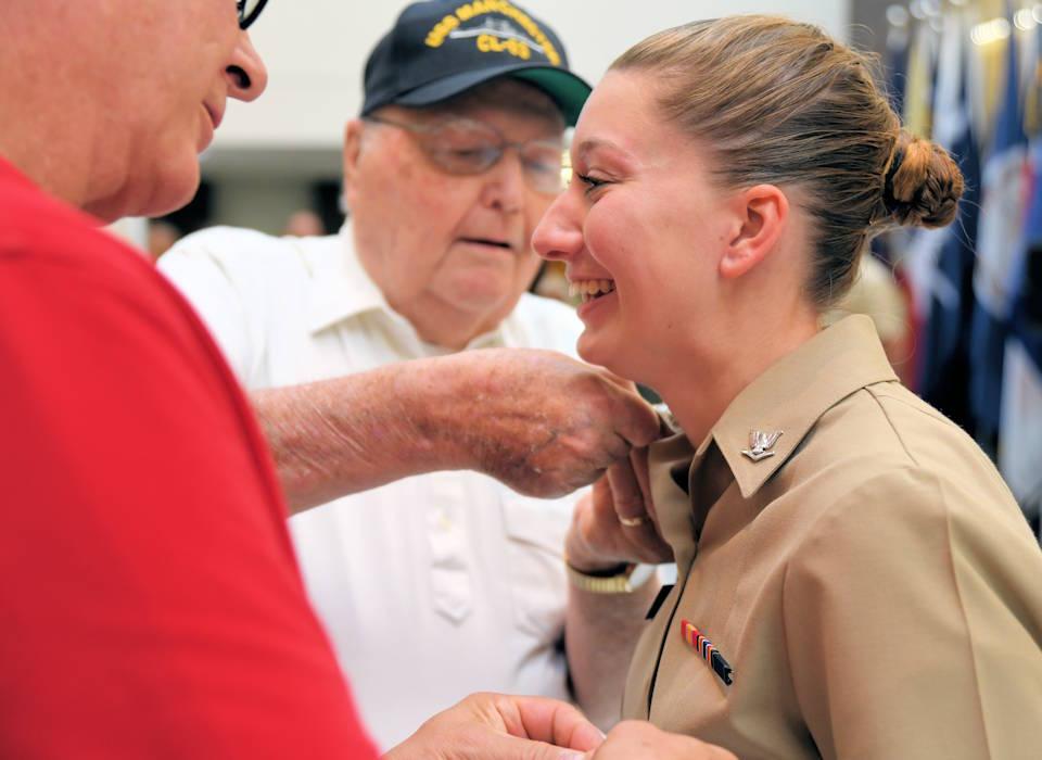 U.S. Navy Hospital Corpsman, 3rd Class, Jennifer Rooney, is pinned by her grandfather, John Rooney, United States Navy Korean War veteran, in a ceremony September 20, 2019, after she was immediately promoted through the Meritorious Promotion Program. Jennifer was also pinned by her father, Robert Rooney, also a Navy veteran of 20 years, making her a third generation Sailor. (U.S. Navy photo by Petty Officer 2nd Class Michael Molina)