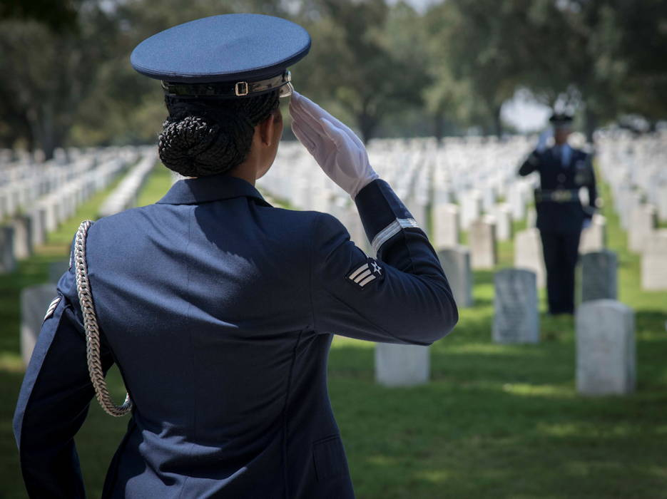 September 9, 2019 - Senior Airman Chyna Roston, 559th Medical Squadron mental health technician, salutes another Joint Base Honor Guardsman while practicing for a funeral service at the Fort Sam Houston National Cemetery. Before each service performed by JBSA Honor Guard, the detail arrives early to practice the service to ensure perfection before performing in front of the family. (U.S. Air Force photo by Airman 1st Class Shelby Pruitt)
