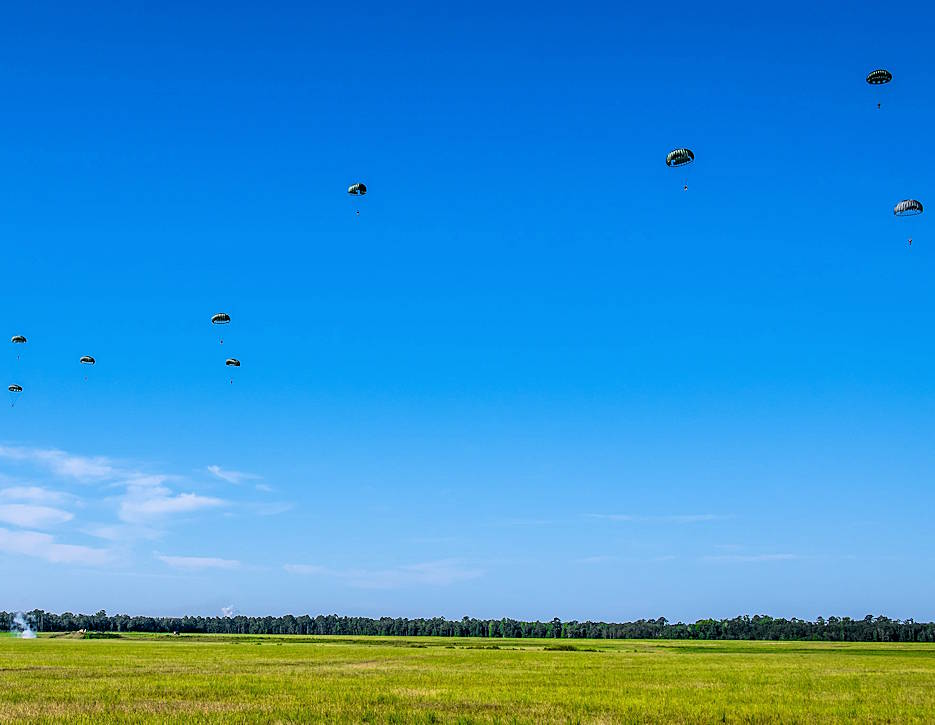 One round of volunteer parachutists from the Liberty Jump Team jump onto Fryar Drop Zone. Maneuver Center of Excellence and Fort Benning commemorated the 2019 National Airborne Day on August 16 at Fryar Drop Zone at Fort Benning. (U.S. Army photo by Patrick Albright, Maneuver Center of Excellence, Fort Benning Public Affairs)