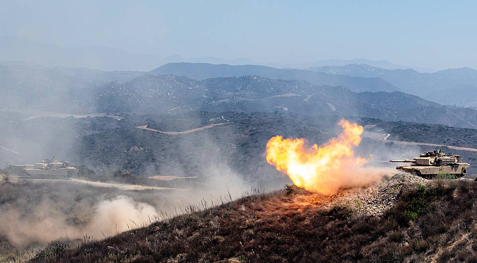 An M1A2 Abrams Main Battle Tank fires during the Tank Gunnery Competition, TIGERCOMP on Marine Corps Base Camp Pendleton on August 29, 2019. TIGERCOMP is an annual force competition that determines the Marine Corps' most lethal tank crew. The winning crew, 4th Tank Battalion, 4th Marine Division, Marine Forces Reserve, will have the opportunity represent the Marine Corps in the Sullivan Cup, which is the Army's total force tank gunnery competition. (U.S. Marine photo by Sgt. Tayler P. Schwamb)