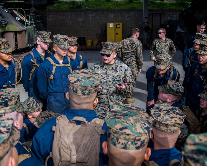 January 28, 2019 - U.S. Marine Corps Sgt. Kevin Storman, (center) platform instructor, Assault Amphibian School (AAS) Battalion, Training Command, calls his students into a school circle at Marine Corps Base Camp Pendleton, California. The students were being evaluated on ground guidance procedures and techniques when guiding an AAV.(U.S. Marine Corps photo by Cpl. Juan Bustos)