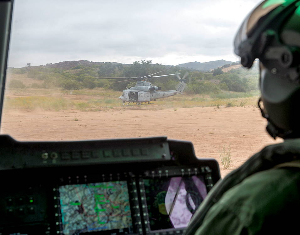 U.S. Marines with Light Attack Helicopter Squadron (HMLA) 469 perform confined area landing (CAL) training with a UH-1Y Venom on Marine Corps Base Camp Pendleton, California on June 25, 2019. CAL training is held for new pilots to get familiar with landing the UH-1Y Venom on tough terrain areas that other aircraft platforms don't have the capability of doing. (U.S Marine Corps photo by Pfc. Andrew Cortez)