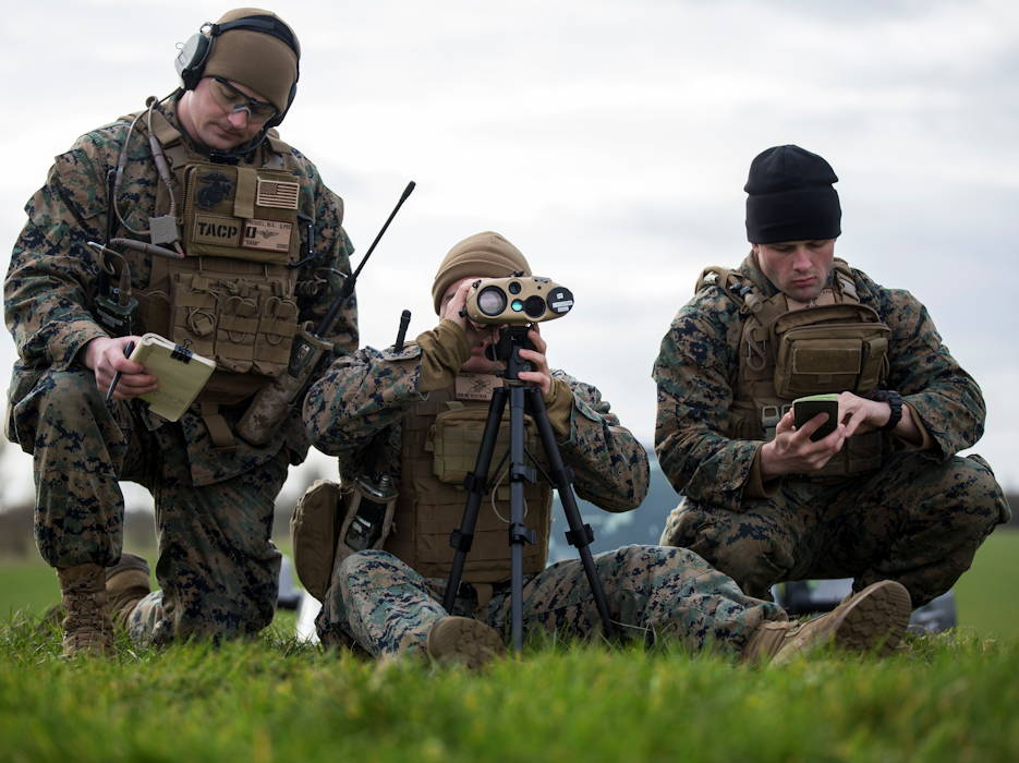February 20, 2019 - U.S. Marines with Special Purpose Marine Air-Ground Task Force-Crisis Response-Africa 19.1 and Marine Rotational Force-Europe 19.1, Marine Forces Europe and Africa, locate simulated enemy positions using a Common Laser Range Finder-Integrated Capability system during a close-air-support training event with the British Royal Air Force at Holbeach Range, England. SPMAGTF-CR-AF is a rotational force deployed to conduct crisis-response and theater-security operations in Europe and Africa. (U.S. Marine Corps photo by Sgt. Katelyn Hunter)