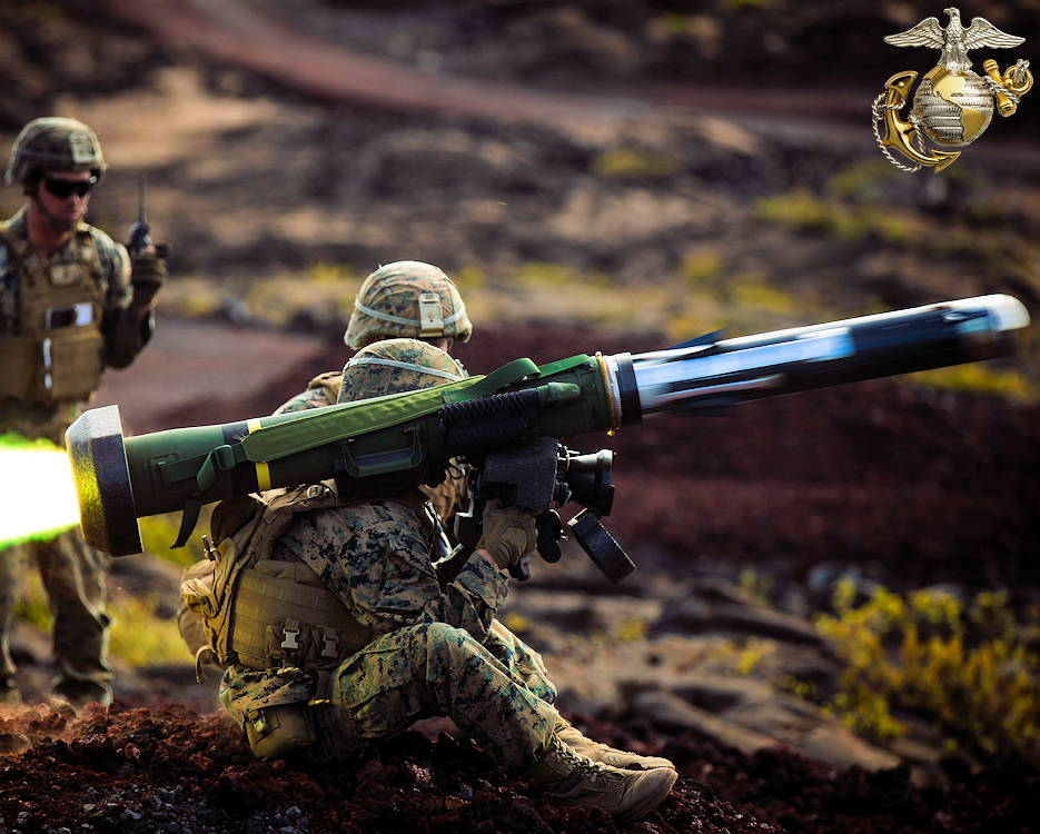 May 15, 2019 - A U.S. Marine with Combined Anti-Armor Team, Weapons Company, 2nd Battalion, 3rd Marine Regiment, fires a shoulder-fired Javelin missile with fellow Marines providing assistance during Exercise Bougainville II on Range 20A, Pohakuloa Training Area, Hawaii. Bougainville II is the second phase of pre-deployment training conducted by the battalion in order to enhance unit cohesion and combat readiness. (Image created by USA Patriotism! from U.S. Marine Corps photo by Lance Cpl. Jacob Wilson)