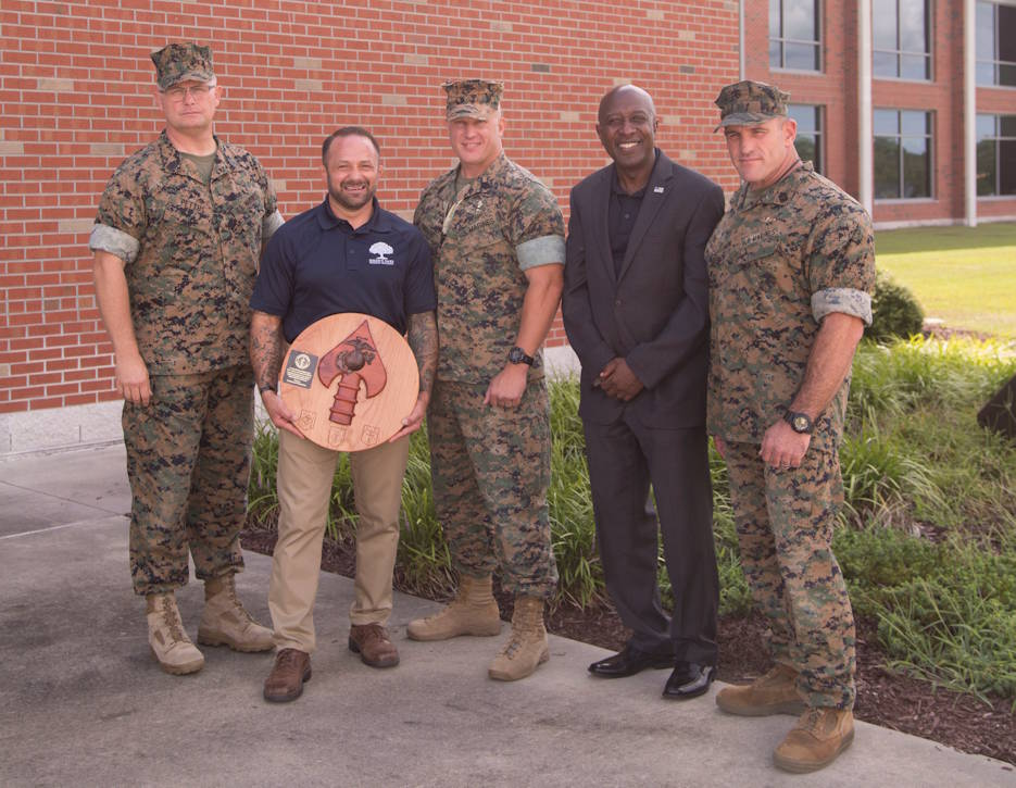 (Left to Right) Master Sgt. Scott Pettus, Chad Robichaux, Sgt. Maj. Dan Knouse, retired Sgt. Maj. Carlton Kent, and Master Sgt. Ryan Evans, pose for a group photo following a military resiliency training event on Marine Corps Base Camp Lejeune, NC on August 12, 2019. Marine Forces Special Operations Command hosted Robichaux, founder of the Mighty Oaks Foundation, to provide information to Marines and Sailors about the Mighty Oaks Warrior Program. The program uses a grassroots approach, empowering veterans and active duty members to begin their healing and then be a positive impact on those in their surrounding communities. (U.S. Marine Corps photo by Sgt. Bryann K. Whitley)