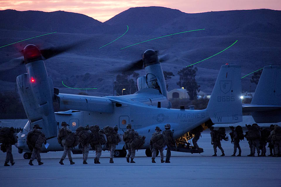 December 10, 2019 - Marines with 1st Marine Division load onto an MV-22B Osprey from Marine Medium Tiltrotor Squadron (VMM) 165, Marine Aircraft Group (MAG) 16, 3rd Marine Aircraft Wing (MAW), for a regimental air assault during exercise Steel Knight on Marine Corps Air Station Camp Pendleton, California. Steel Knight is an annual exercise that integrates 3rd MAW's combat power and capabilities with those of 1st Marine Division. This exercise provides the Marines and sailors of 3rd MAW with realistic and relevant training, which enhances their skills, tactics and combat readiness. (U.S. Marine Corps photo by Warrant Officer Justin M. Pack)