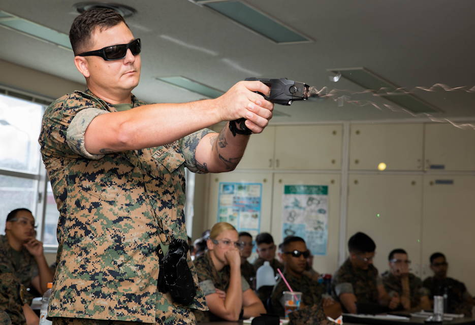 U.S. Marine Corps Staff Sgt. Robert A. Votta, Provost Marshal's Office, a non-lethal weapons instructor with Provost Marshal's Office, Headquarters and Support Battalion, Marine Corps Installations Pacific, instructs a course during Human Electro-muscular Incapacitation Taser training at Camp Foster, Okinawa, Japan, Oct. 22, 2019. This training is conducted to help Marines familiarize themselves with the nomenclature and employment of the non-lethal weapon. (U.S. Marine Corps photo by Cpl. Kayla V. Staten)
