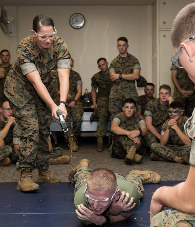 U.S. Marines assigned to Provost Marshal's Office, Headquarters and Support Battalion, Marine Corps Installations Pacific, undergo Human Electro-muscular Incapacitation Taser training at Provost Marshal's Office, Headquarters and Support Battalion, Marine Corps Installations Pacific, Camp Foster, Okinawa, Japan, Oct. 22, 2019. (U.S. Marine Corps photo by Cpl. Kayla V. Staten)
