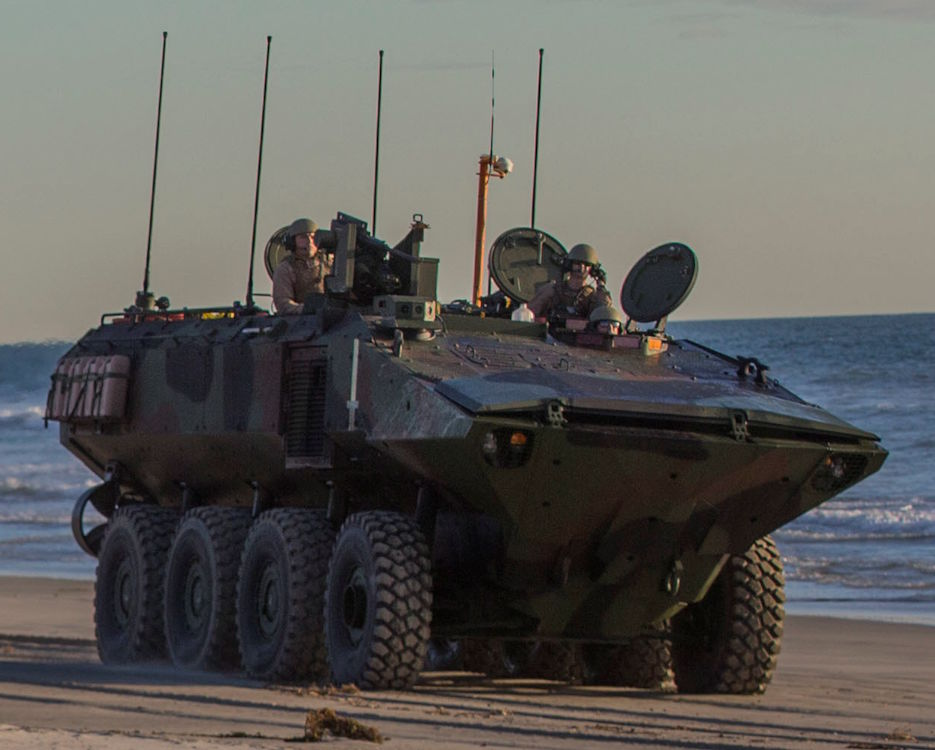 U.S. Marines with Amphibious Vehicle Test Branch, Marine Corps Tactical Systems Support Activity, drive a new Amphibious Combat Vehicle along the beach during low-light surf transit testing at AVTB Beach on Marine Corps Base Camp Pendleton, California, Dec. 18, 2019. The test was designed to assess and verify how well Marines can interface with the vehicle and operate at night. The ACV is an eight-wheeled armored personnel carrier designed to fully replace the Corps' aging fleet of Amphibious Assault Vehicles. (U.S. Marine Corps photo by Lance Cpl. Andrew Cortez)