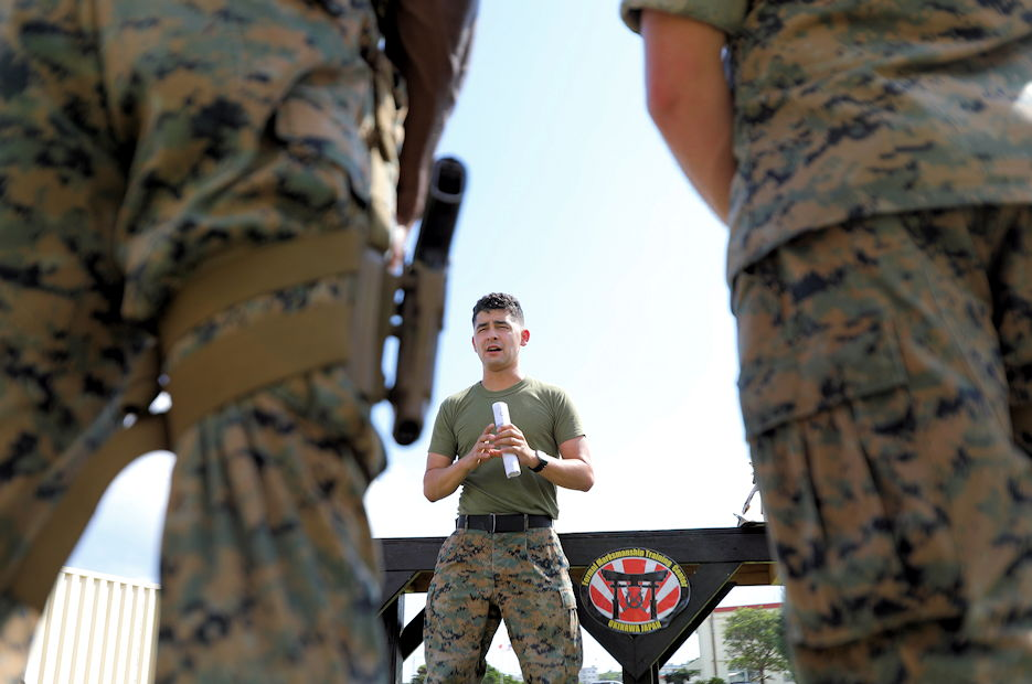 U.S. Marine Corps Sgt. Angel Jaramillo, a native from Goldsborough, North Carolina and a combat marksmanship trainer, teaches hand and arm signals during the Combat Marksmanship Coaching (CMC) course on Camp Hansen, Okinawa, Japan, Oct. 29, 2019. The CMC course develops Marines to be proficient marksmanship coaches in order to enhance combat effectiveness of the Marine Corps. (U.S. Marine Corps photo by Lance Cpl. Alexandria Nowell)
