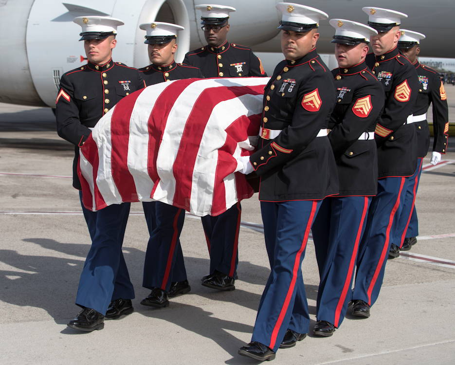 May 17, 2019 - Marines assigned to the 6th Engineer Support Battalion, Bulk Fuel Company Charlie, Site Support Phoenix, carry a fallen Marine in a flag-draped transfer case during a dignified transfer at the Phoenix Sky Harbor International Airport, Arizona. Dignified transfers are when fallen service members are transported from an aircraft to an awaiting transport vehicle. The fallen Marine, Lance Cpl. Justin A. Hinds, was an Avondale, Arizona native. (U.S. Air Force photo by Airman Brooke Moeder)