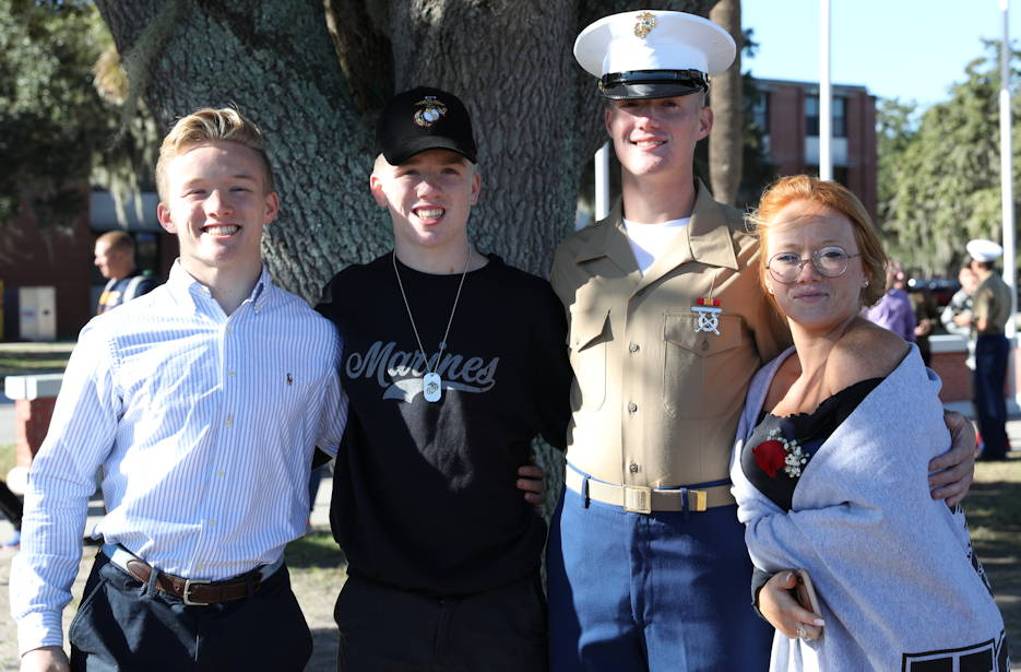 November 1, 2019 - Marine Corps PFC Paul Hasenfus with his three siblings after graduting from boot camp at Marine Corps Recruit Depot Parris Island. (U.S. Marine Corps photo by Lance Cpl. Ryan Hageali)
