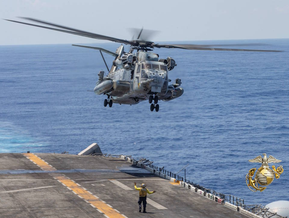 October 9, 2019 - A CH-53E Super Stallion with Marine Medium Tiltrotor Squadron (VMM) 163 (Reinforced), 11th Marine Expeditionary Unit (MEU), takes off of the flight deck of the amphibious assault ship USS Boxer (LHD 4) during a vertical replenishment-at-sea. (Image created by USA Patriotism! from U.S. Marine Corps photo by Cpl. Dalton S. Swanbeck)