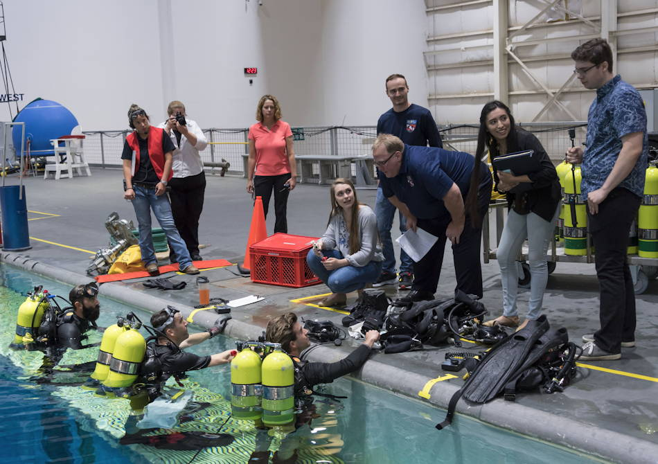 Lone Star College-CyFair Team CERO members guide the divers at the Neutral Buoyancy Laboratory as their developed tool is tested. (NASA courtesy photo)