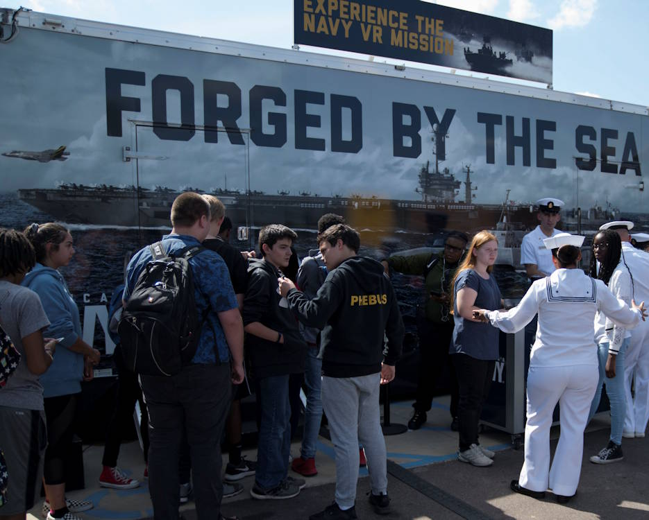 October 1, 2019 - U.S. Navy recruiters speak to White Station High School students about Navy career opportunities during Memphis Swarm. Swarming is Navy Recruiting Command's new recruiting strategy in support of the national policy to build a 355-ship Navy. (U.S. Navy photo by Mass Communication Specialist 3rd Class Cody Anderson)