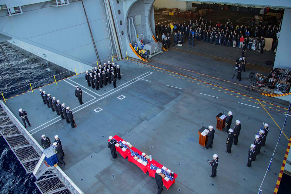 November 11, 2019 - Sailors assigned to the aircraft carrier USS Gerald R. Ford (CVN 78) participate in a burial at sea ceremony on the ship's aircraft elevator three. Thirty souls were laid to rest during the first burial at sea ceremony held aboard Ford. (U.S. Navy photo by Mass Communication Specialist Seaman Apprentice Zack Guth)