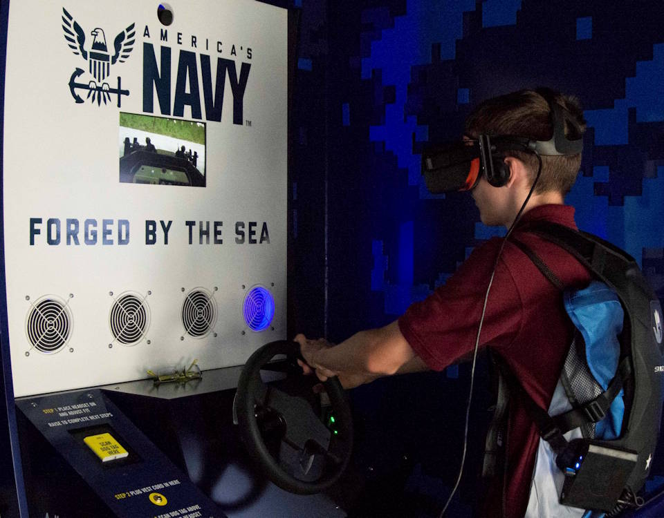 October 3, 2019 - Charles Karnes, a student of Liberty High School, participates in the Navy's virtual reality asset, the Burke, during Memphis Swarm. Swarming is Navy Recruiting Command's new recruiting strategy in support of the national policy to build a 355-ship Navy. (U.S. Navy photo by Mass Communication Specialist 2nd Class Bridget Saunders)