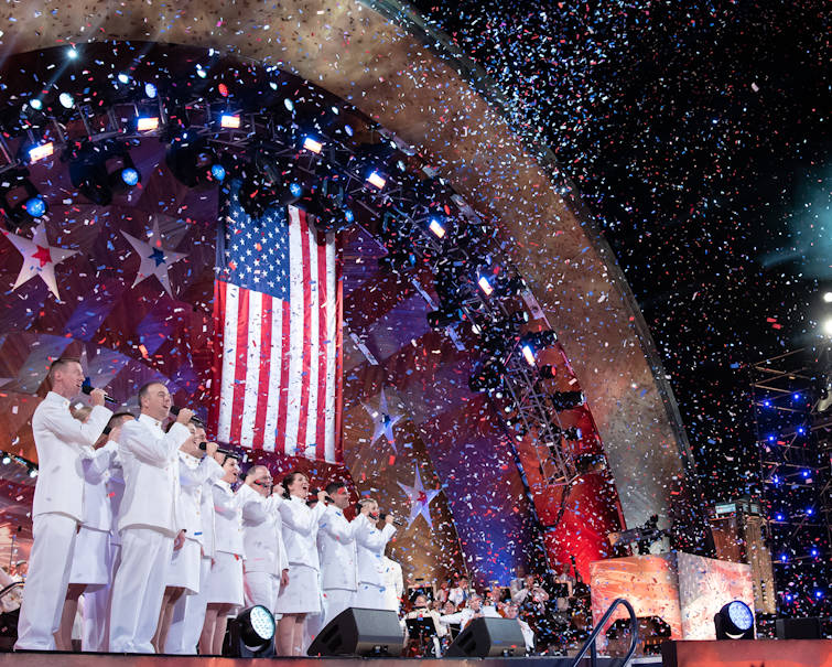 July 4, 2019 - Members of the U.S. Navy Band Sea Chanters chorus perform at the Hatch Memorial Shell on the Charles River Esplanade in Boston. The Navy Band visited Boston to perform in Independence Day celebrations with the Boston Pops Orchestra, Queen Latifah, Arlo Guthrie, the Texas Tenors, and others. (U.S. Navy photo by Senior Chief Musician Adam Grimm)