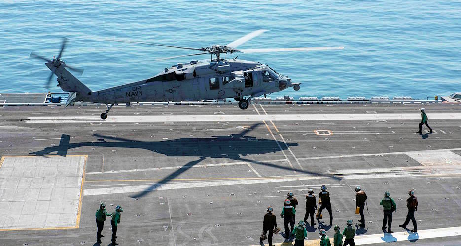 "September 7, 2019 - An MH-60S Seahawk, assigned to the ""Dusty Dogs"" of Helicopter Sea Combat Squadron (HSC) 7, lands on the flight deck aboard the aircraft carrier USS Dwight D. Eisenhower (CVN 69). (U.S. Navy photo by Mass Communication Specialist Seaman Apprentice Neadria Hazel)"