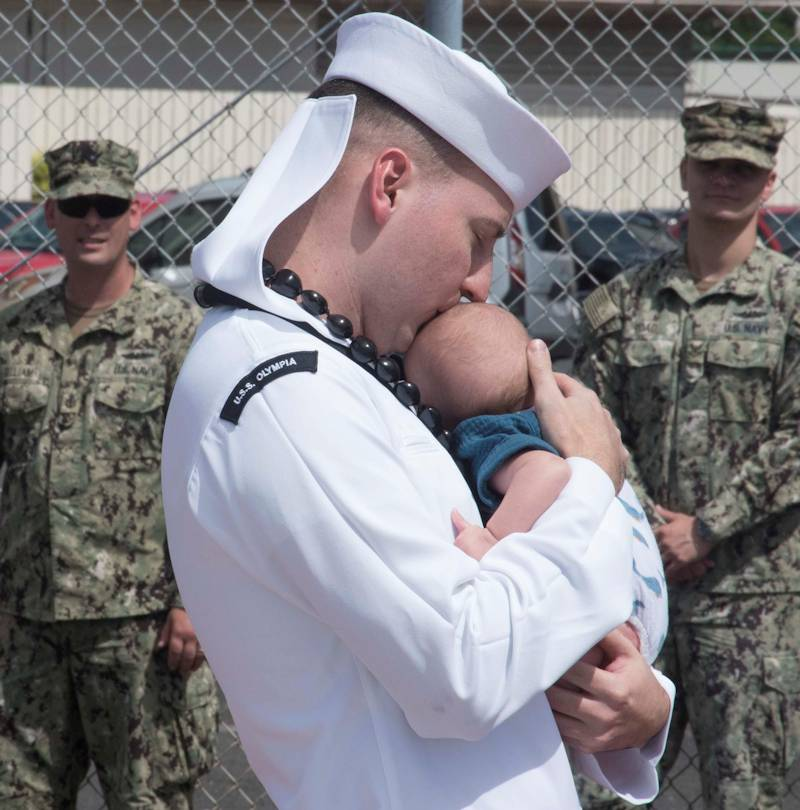 September 8, 2019 - Electrician's Mate 2nd Class (Nuclear) Henry Wagner, from Baltimore, Maryland, assigned to the Los Angeles-class fast-attack submarine USS Olympia (SSN 717), holds his newborn son for the first time during Olympia's homecoming. The USS Olympia returned from a seven-month, around-the-world deployment in support of maritime security operations with allies and partners to ensure high-end war fighting capabilities in this era of great power competition. (U.S. Navy photo by Mass Communication Specialist 1st Class Amanda Gray)