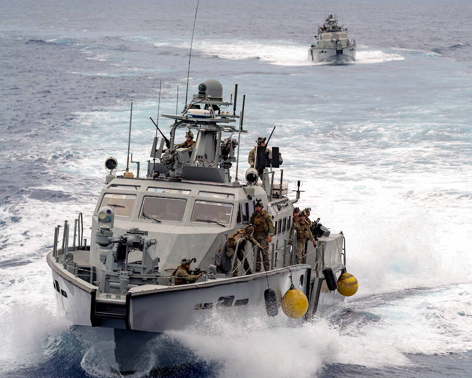 August 26, 2019 -  U.S. Navy Mark VI patrol boats attached to Coastal Riverine Squadron (CRS) 2 with embarked Marines assigned to 3rd Reconnaissance Battalion, 3rd Marine Division and Clearance Divers assigned to the Royal Canadian Navy's Fleet Diving Pacific and Atlantic Units, navigate near Apra Harbor, Guam ... during a visit, board, search and seizure (VBSS) subject matter expert knowledge exchange as part of Exercise HYDRACRAB. (U.S. Navy photo by Mass Communication Specialist 2nd Class Jasen Moreno-Garcia)
