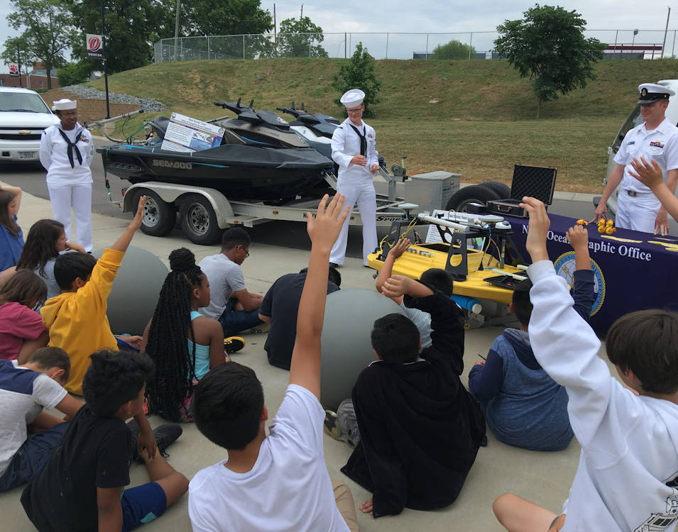 Fleet Survey Team Sailors quiz John Overton High School STEM campers with trivia questions following their presentation on near-shore hydrographic surveys on June 4, 2019 during Nashville Navy Week. (U.S. Navy photo by Rebecca Eckhoff, FST)