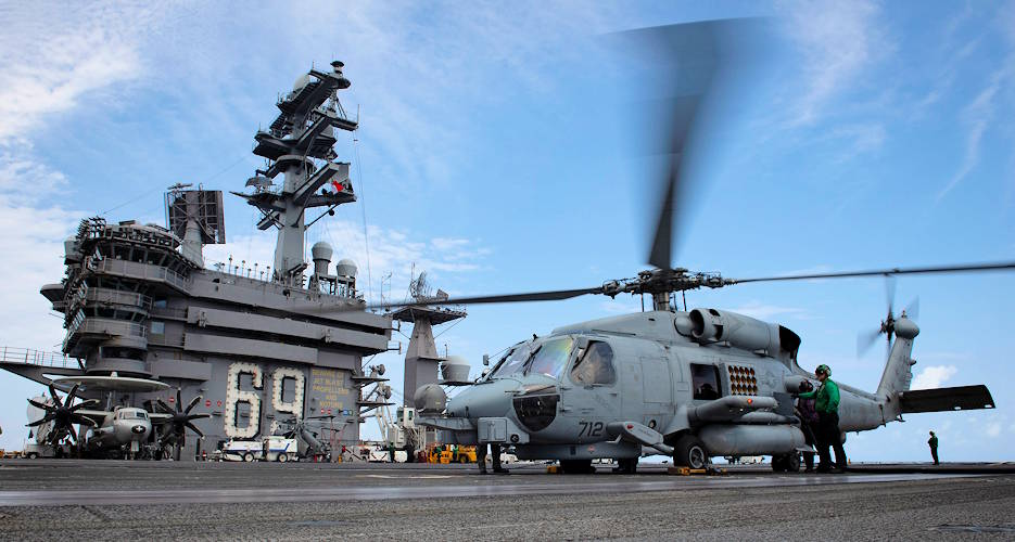 "September 18, 2019 - An MH-60R Seahawk, assigned to the ""Swamp Foxes"" of Helicopter Maritime Strike Squadron (HMS) 74, refuels on the flight deck aboard the aircraft carrier. (U.S. Navy photo by Mass Communication Specialist 3rd Class Kaleb J. Sarten)"